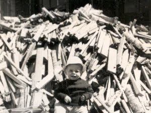 infant jim degerstrom and woodpile