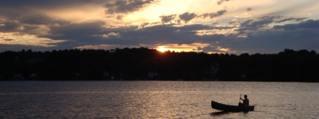 canoe at sunset on maine lake