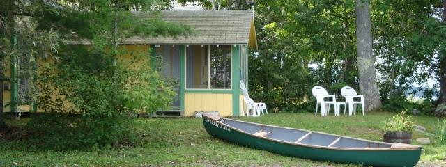 maine cottage and green canoe